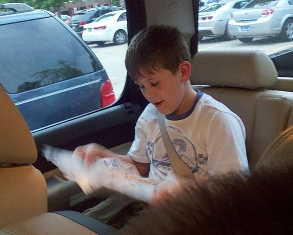 Ethan Reading Newspaper 2