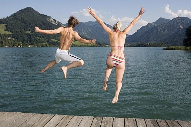 Couple Jumping into lake
