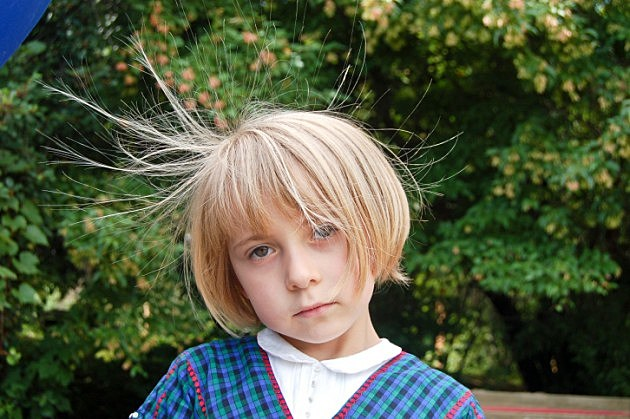 Frowning Girl With Static Hair - credit - iStock - 186914783