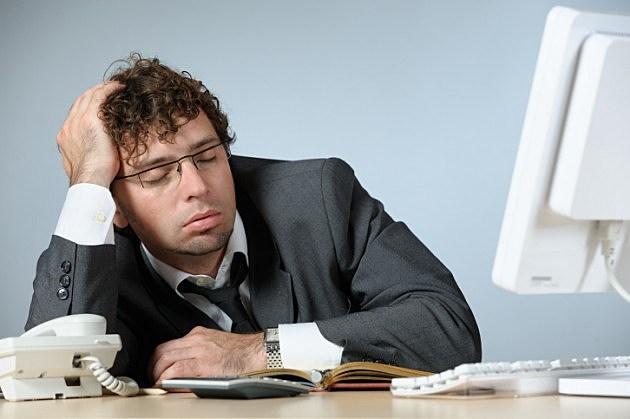 Office guy sleeping cedit iStock