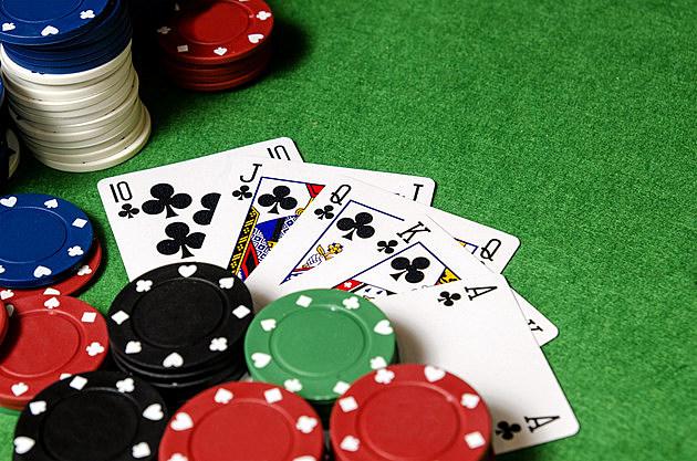 royal flush of shamrocks between betting chips.