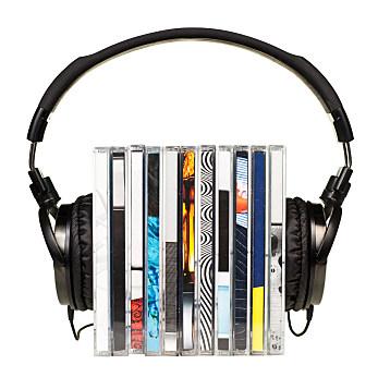 Headphones on stack of CDs