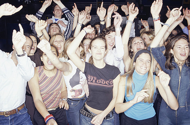 Large group of teenagers dancing at club, portrait